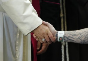 Pope Francis shakes hands with an inmate as he meets with prisoners at Curran-Fromhold Correctional Facility in Philadelphia, September 27, 2015. REUTERS/Jonathan Ernst